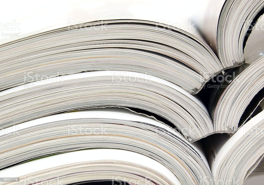 Close-up of stacked books opened to center royalty-free stock photo