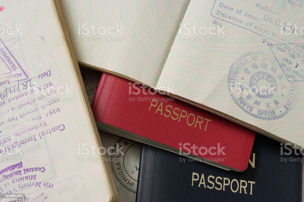 Close-up of stacked passports and stamp page stock photo