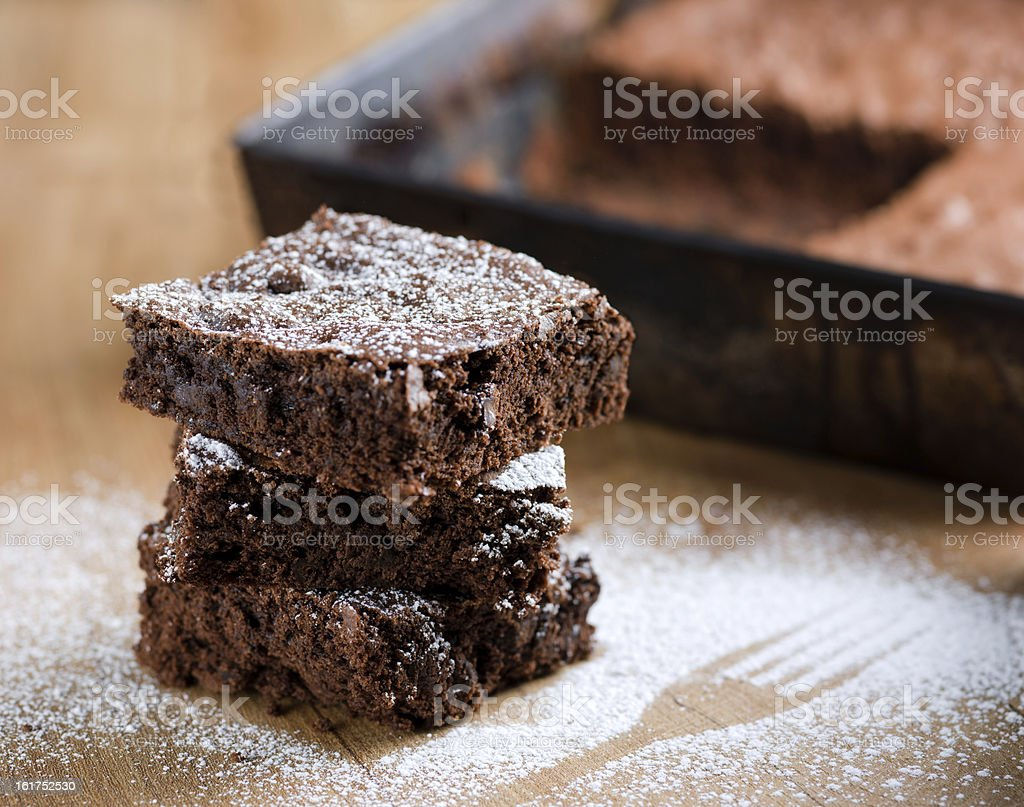 Close-up of stacked pieces of brownies with powdered sugar stock photo