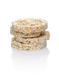 A closeup of stacked rice cakes on a white background