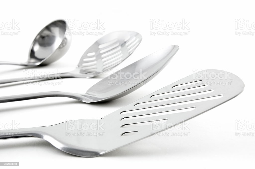 Close-up of stainless kitchen utensils stock photo