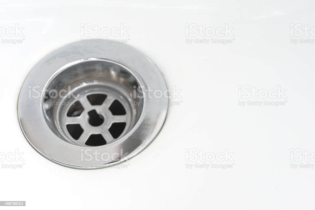 Closeup of stainless steel drain stock photo