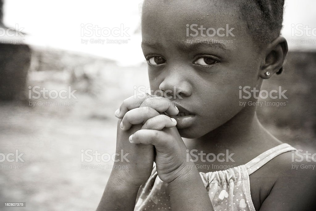 Close-up of starving African girl biting her nail stock photo