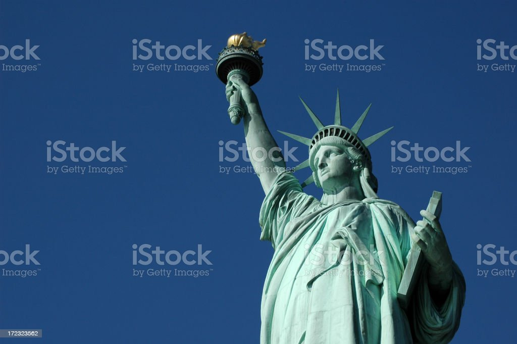 Close-up of Statue of Liberty against bright blue sky royalty-free stock photo