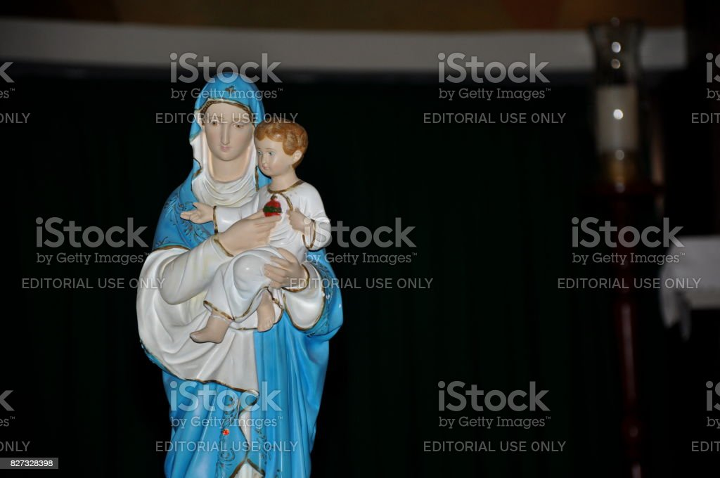 Close-up of statuette with image of Our Lady holding the boy Jesus in the Santuário das Almas church. stock photo