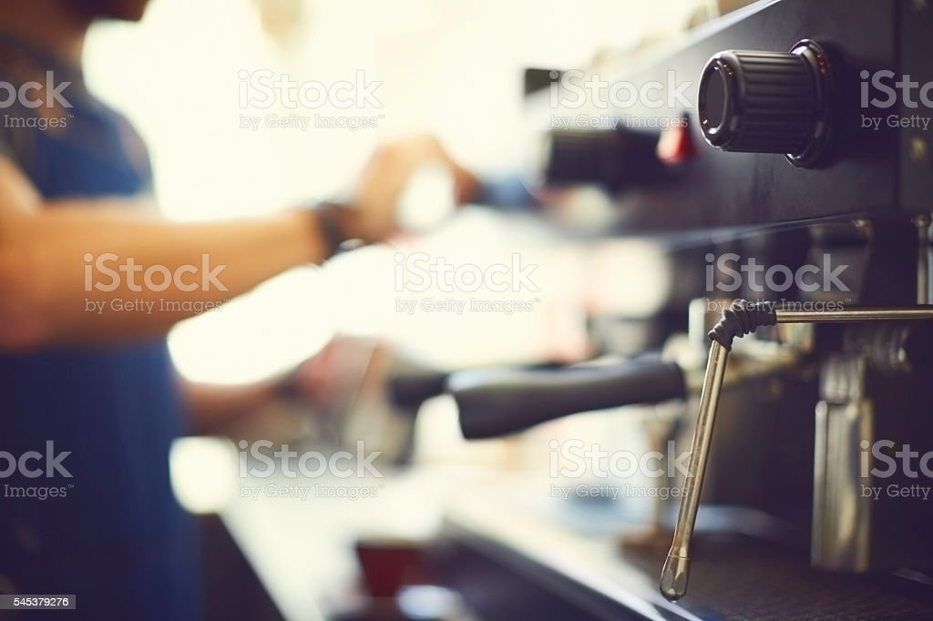 Close-up of steamer and knob on coffee maker stock photo