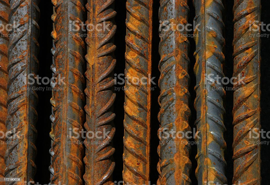 Close-up of steel bars with indentations and some rust royalty-free stock photo