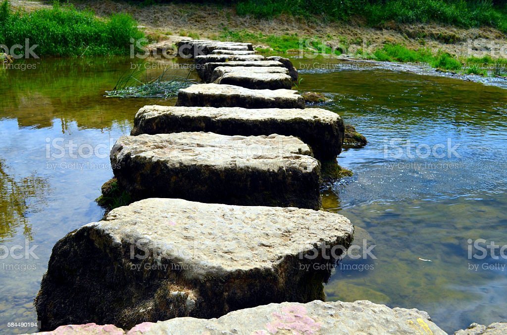 closeup of stepstones crossing a small river stock photo