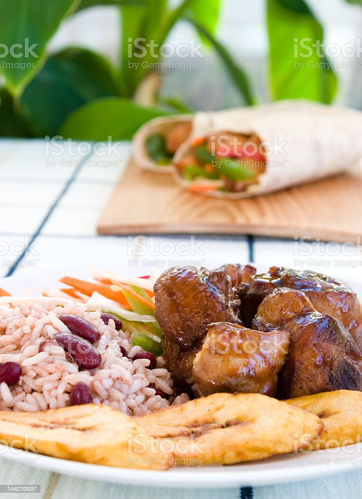 A close-up of stewed chicken with rice and vegetables stock photo