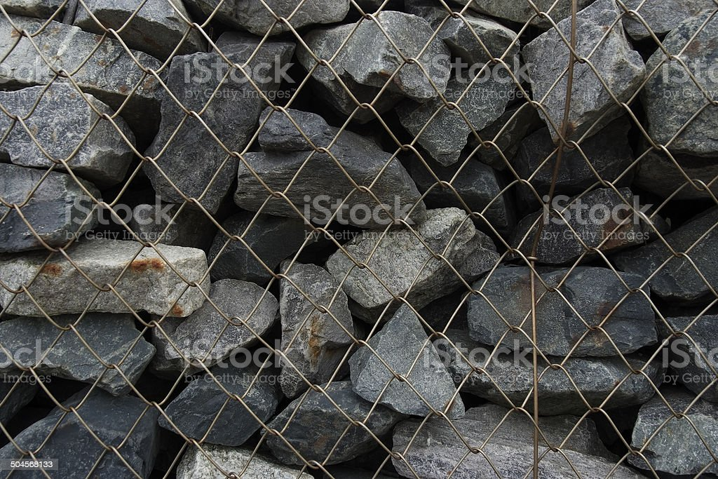 Close-up of stone wall textured with wire mesh royalty-free stock photo