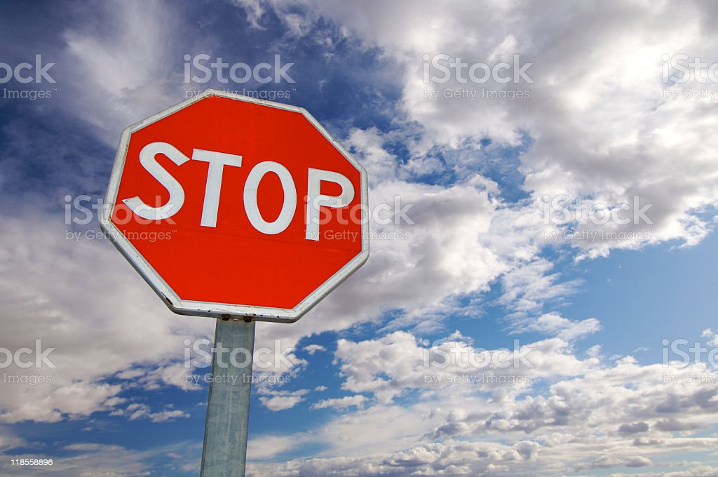 Close-up of stop sign against clear blue skies background stock photo