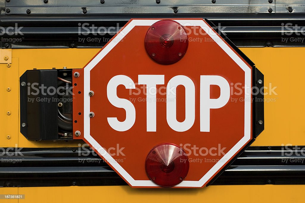 Close-up of stop sign on yellow school bus royalty-free stock photo