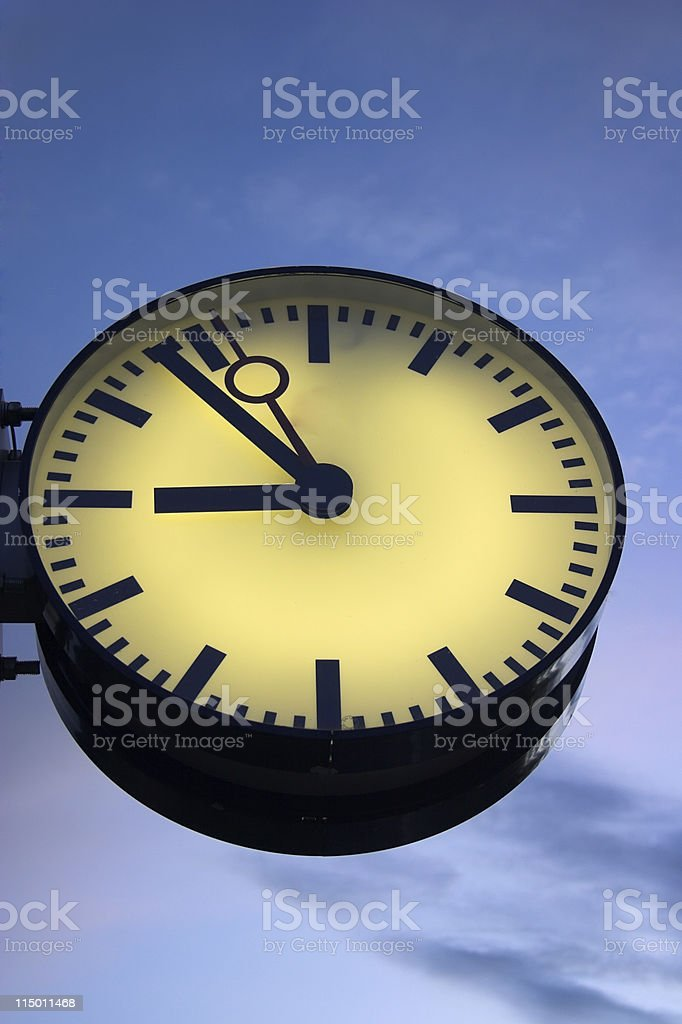 Close-up of street clock on sky background stock photo