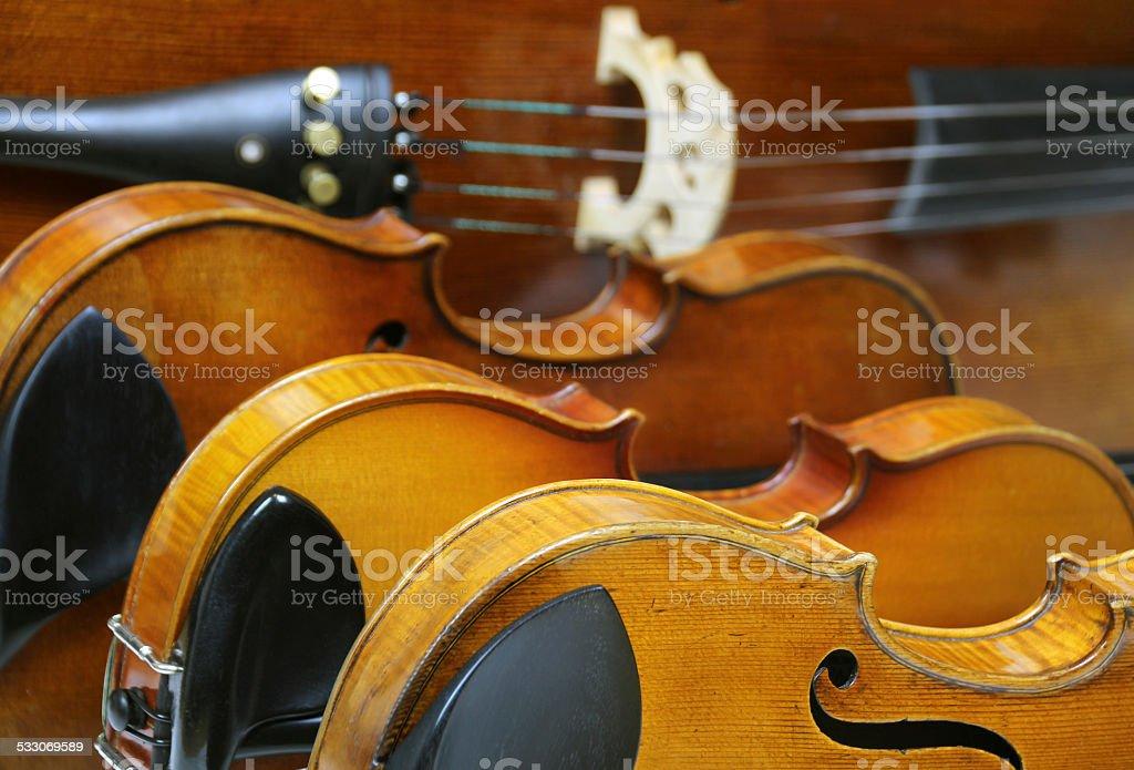 Close-up of String Quartet Instruments: Violins, Viola, and Violoncello stock photo