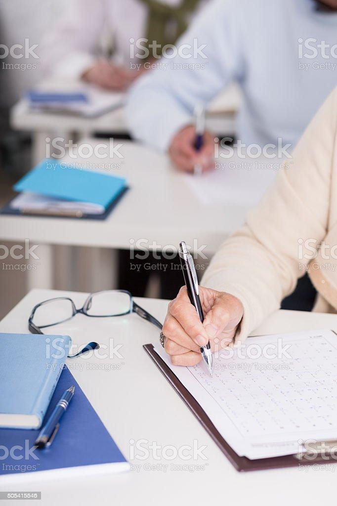 Close-up of student writing exam stock photo