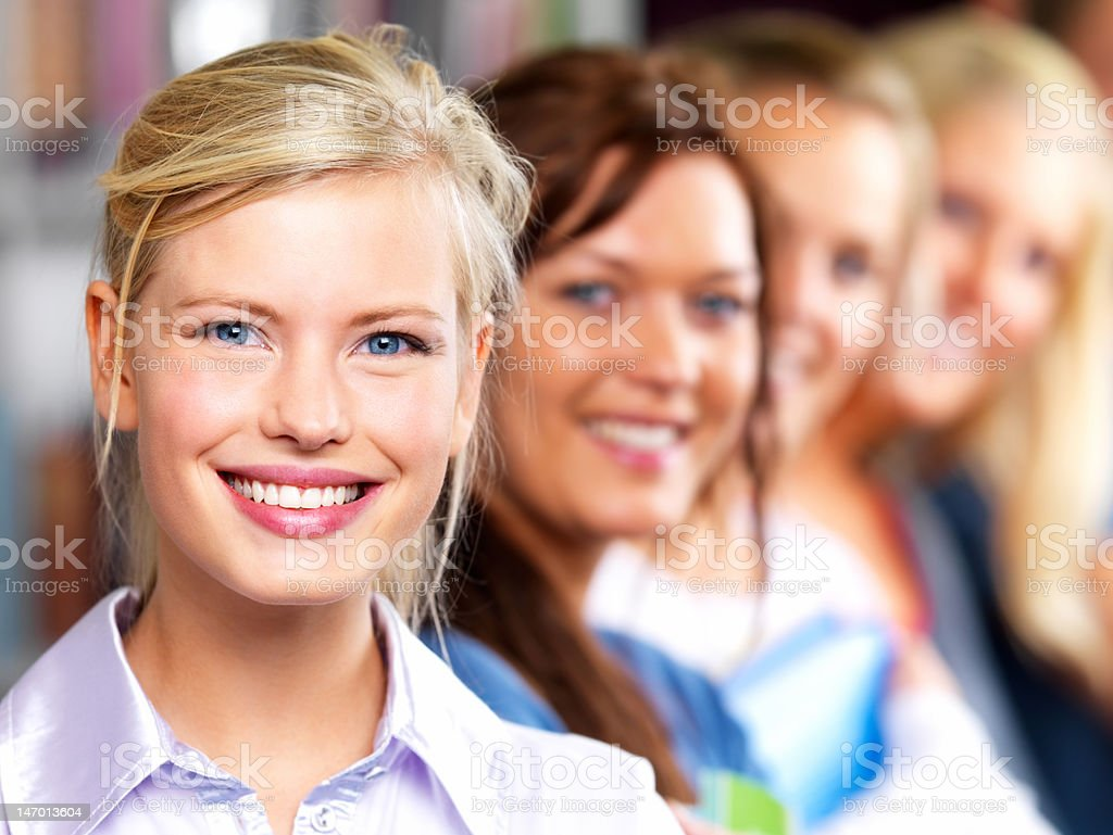 Close-up of students smiling in a row royalty-free stock photo