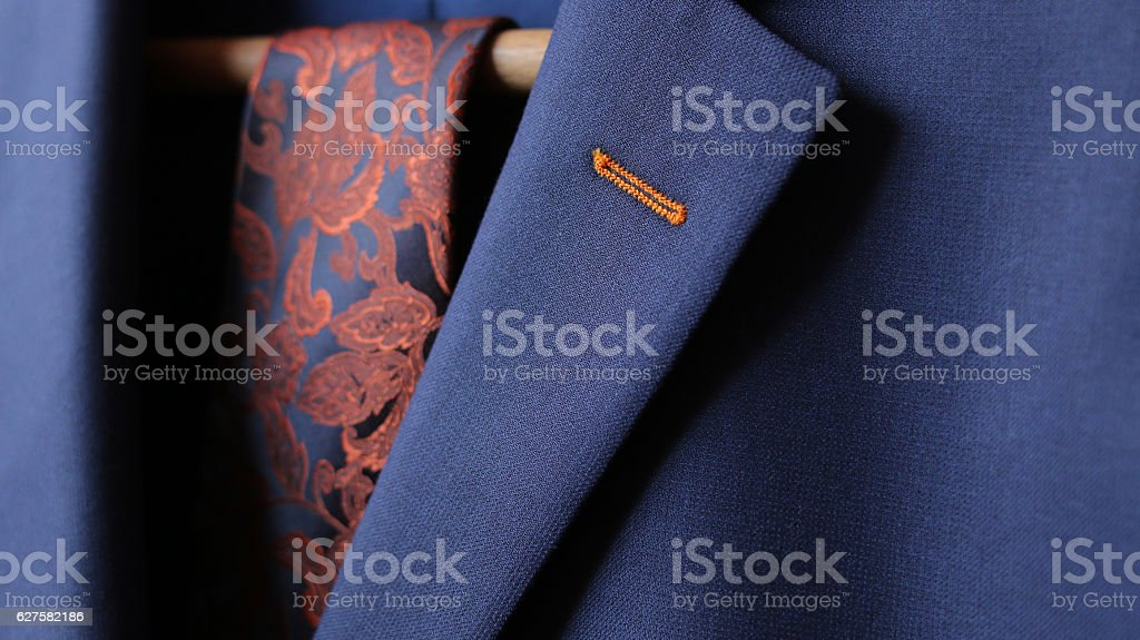close-up of suit jacket lapel button hole fabric stock photo