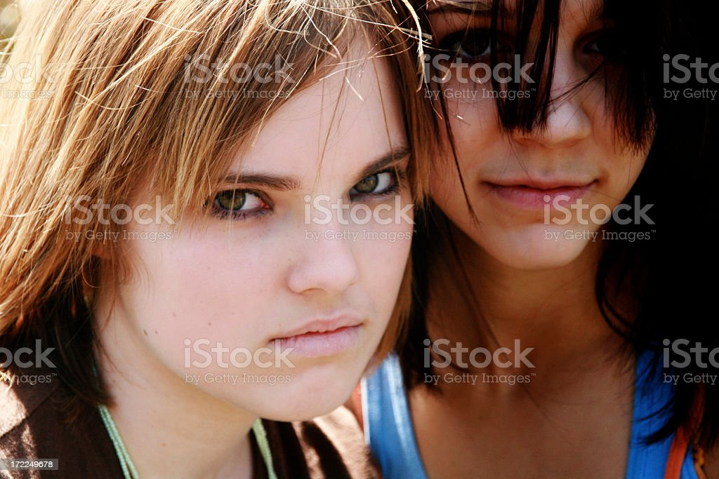 Close-up of sullen looking teenage girls  royalty-free stock photo