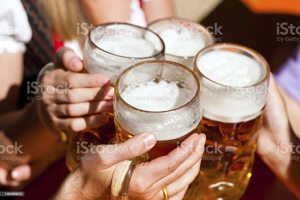 Close-up of summertime beer mugs containing fresh beer stock photo
