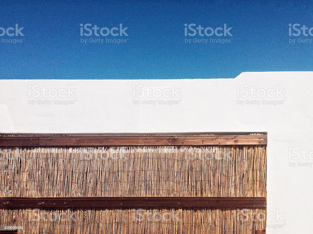 Close-up of sunny building with wood-lath part, suitable for copyspace stock photo