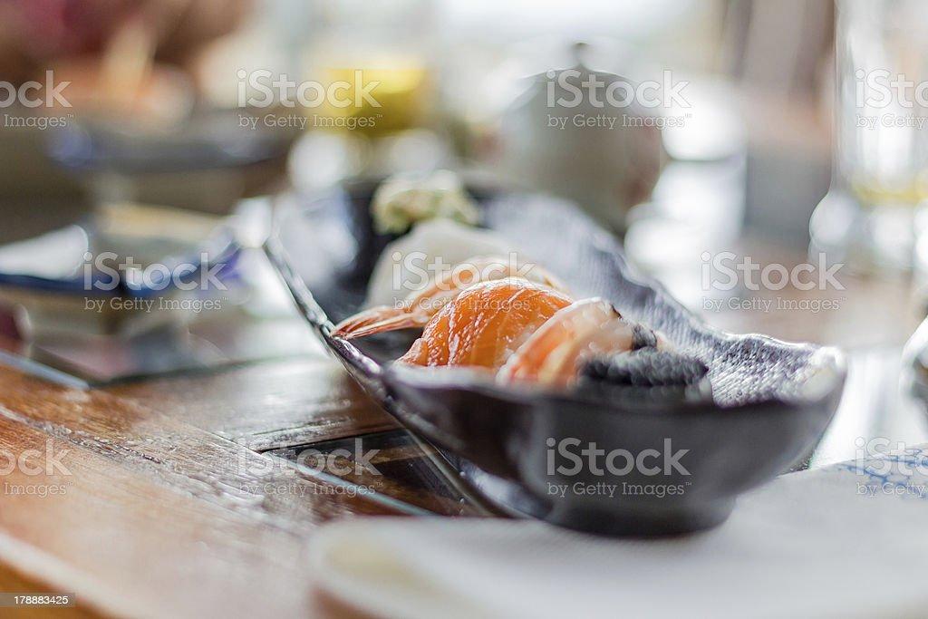 Closeup of sushi set on black plate royalty-free stock photo