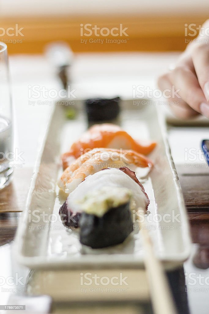 Closeup of sushi set on white plate royalty-free stock photo