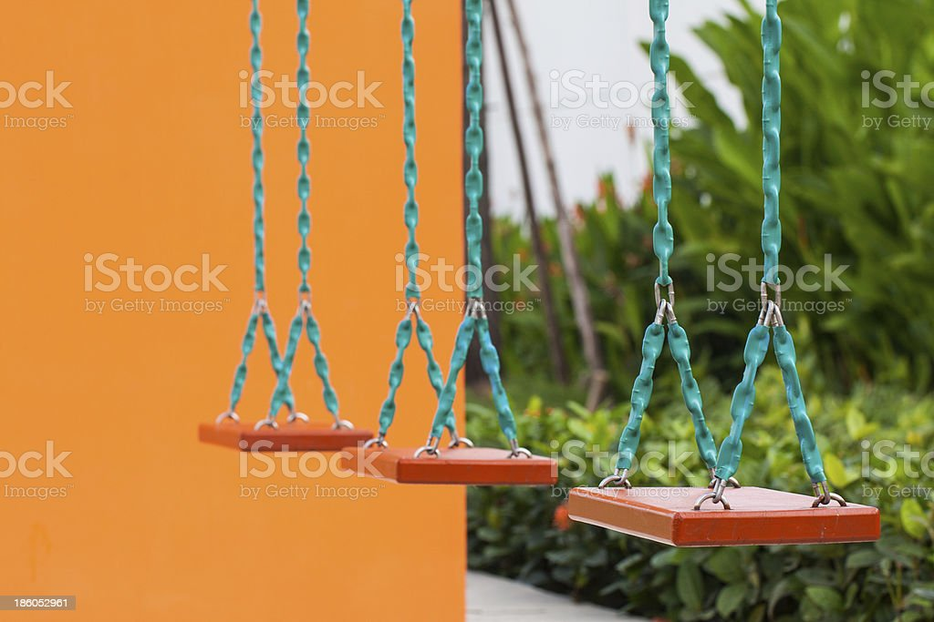 Closeup of swings in a children play area royalty-free stock photo