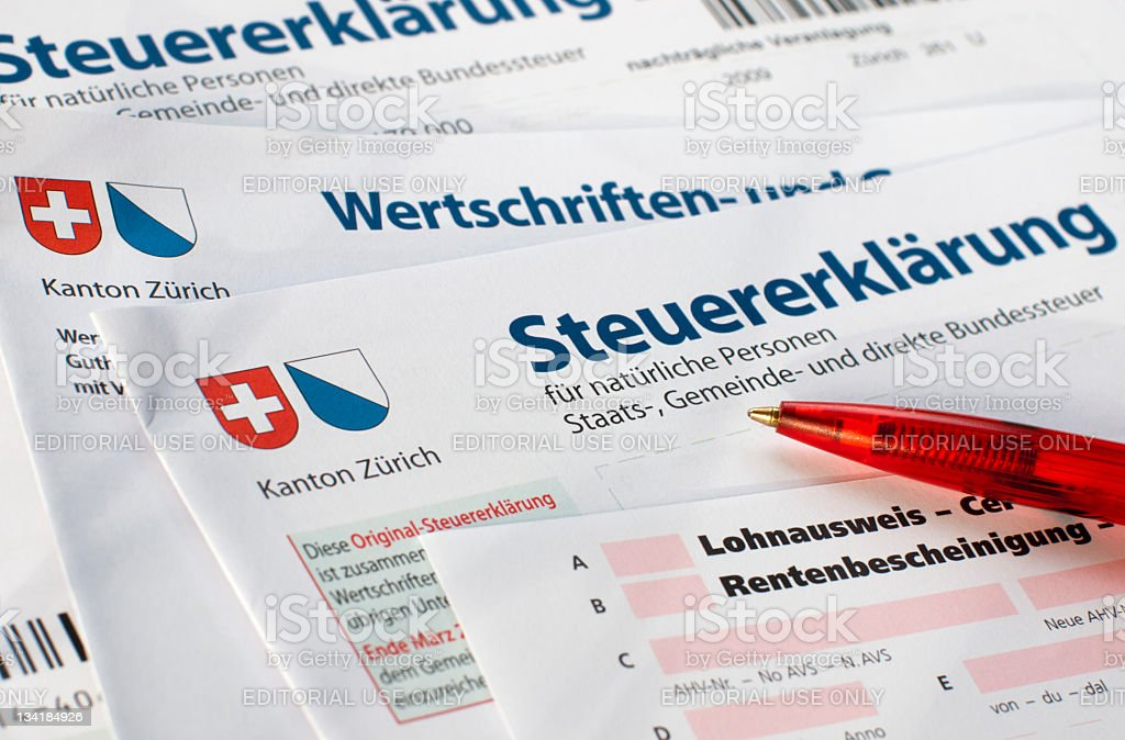 Close-up of swiss tax form with red pencil royalty-free stock photo