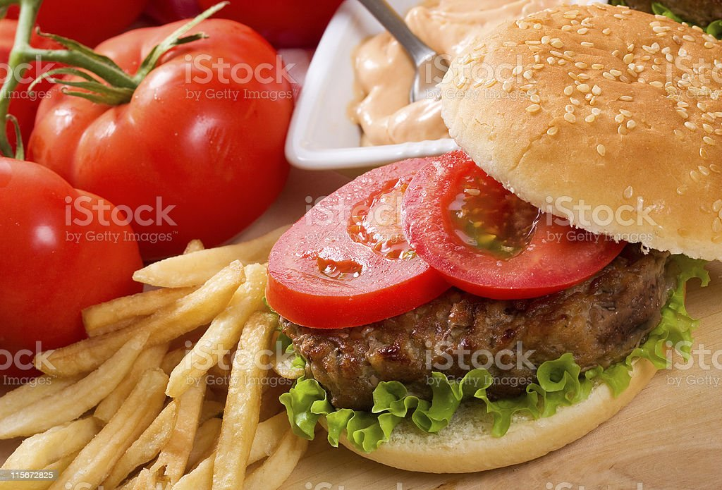 Close-up of tasty hamburger with meat and fresh vegetables royalty-free stock photo