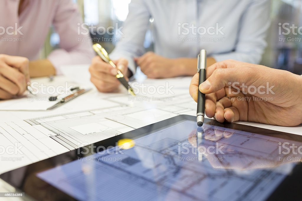 Close-up of Team architects working on construction project in o stock photo