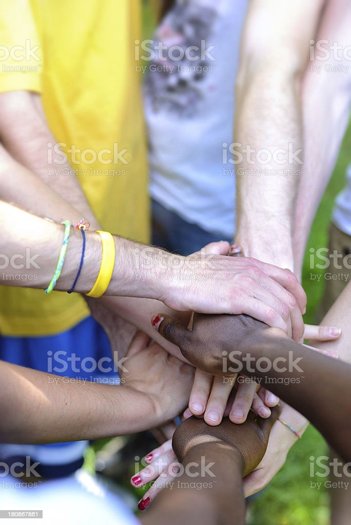 Close-up of team joining hands royalty-free stock photo