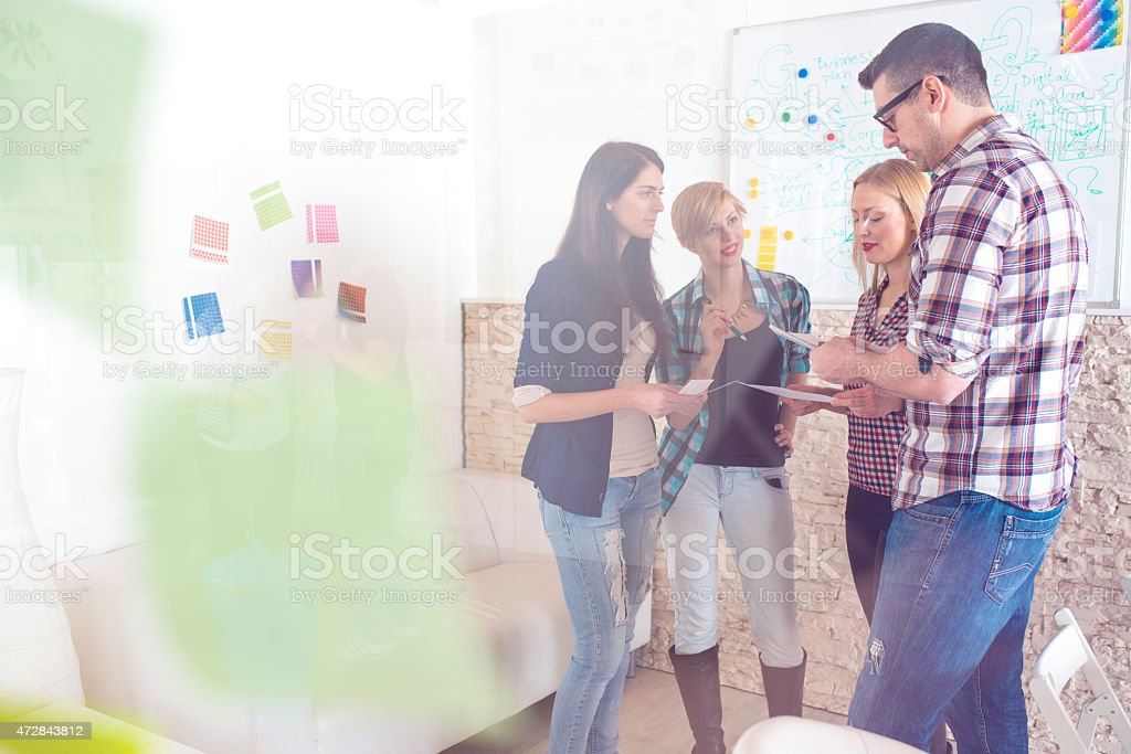 Close-up of team working together on project stock photo