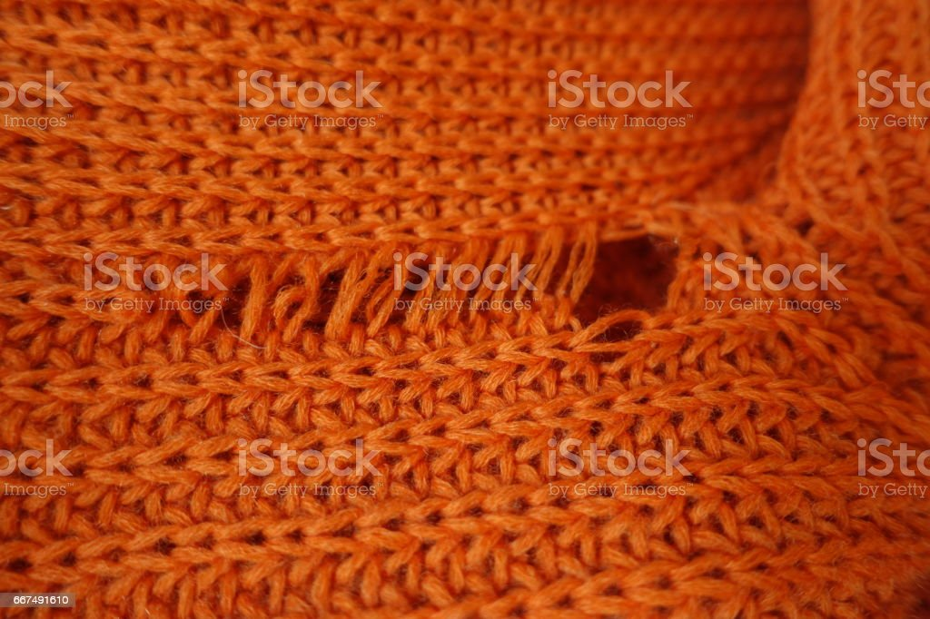 Close-up of tear in knit fabric stock photo