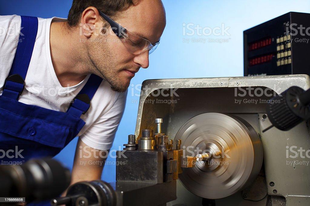 Close-up of technician working on lathe machine stock photo