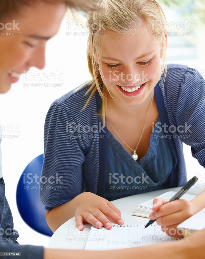 Close-up of teenage boys and girls doing homework together royalty-free stock photo