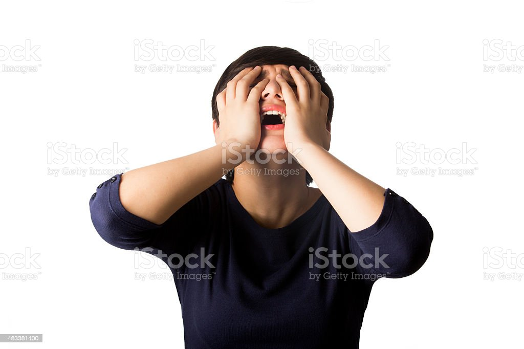 Close-up of teenage girl screaming sadly stock photo