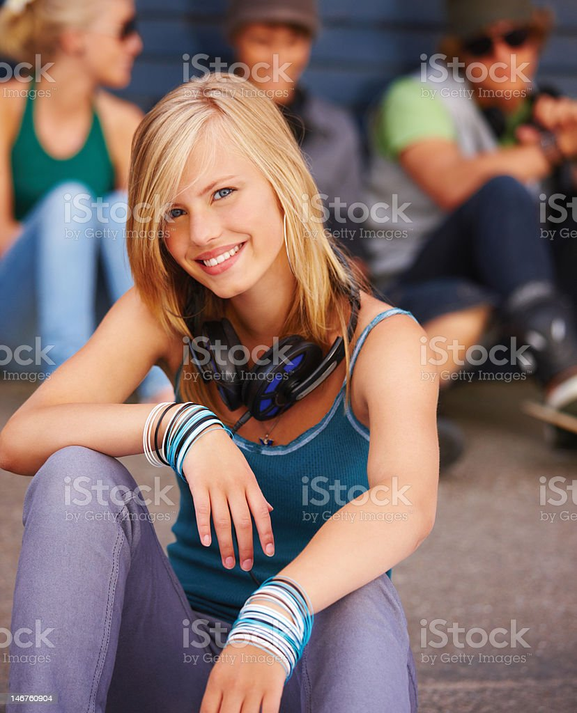 Close-up of teenage girl with friends sitting in the background royalty-free stock photo