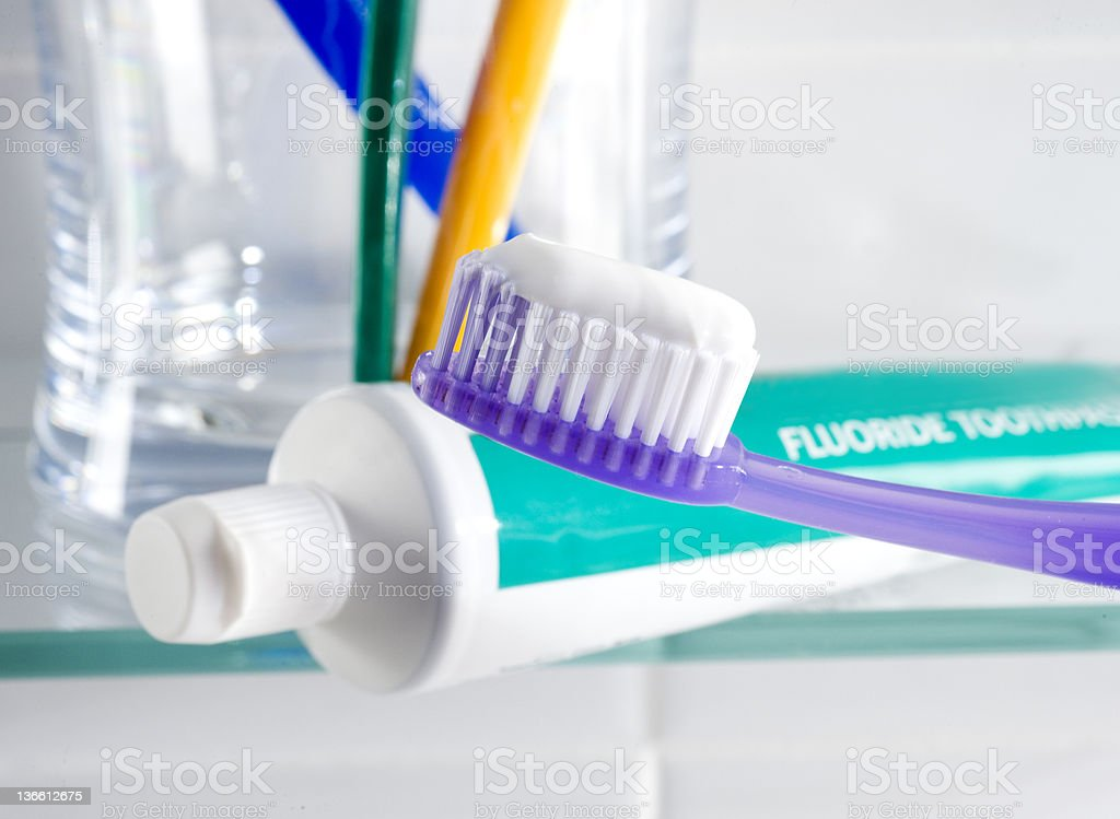 Close-up of teeth-brushing items in a bathroom stock photo