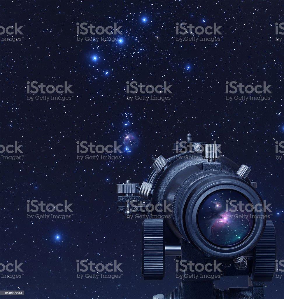 Close-up of telescope on astronomy background stock photo