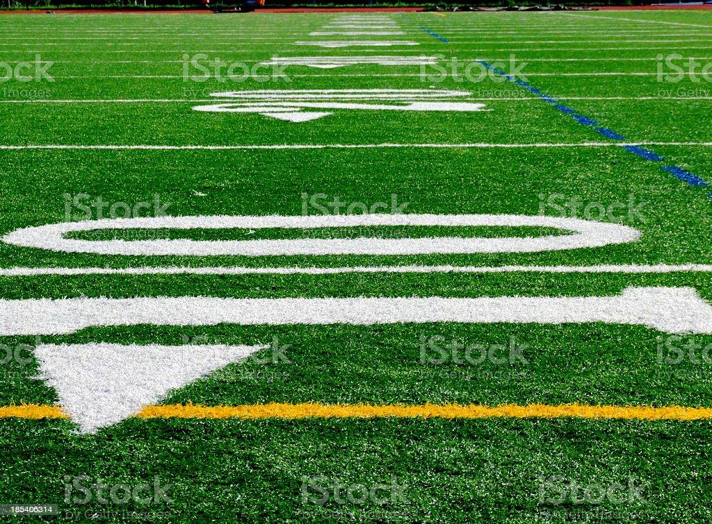 Closeup of ten yard line on football field royalty-free stock photo