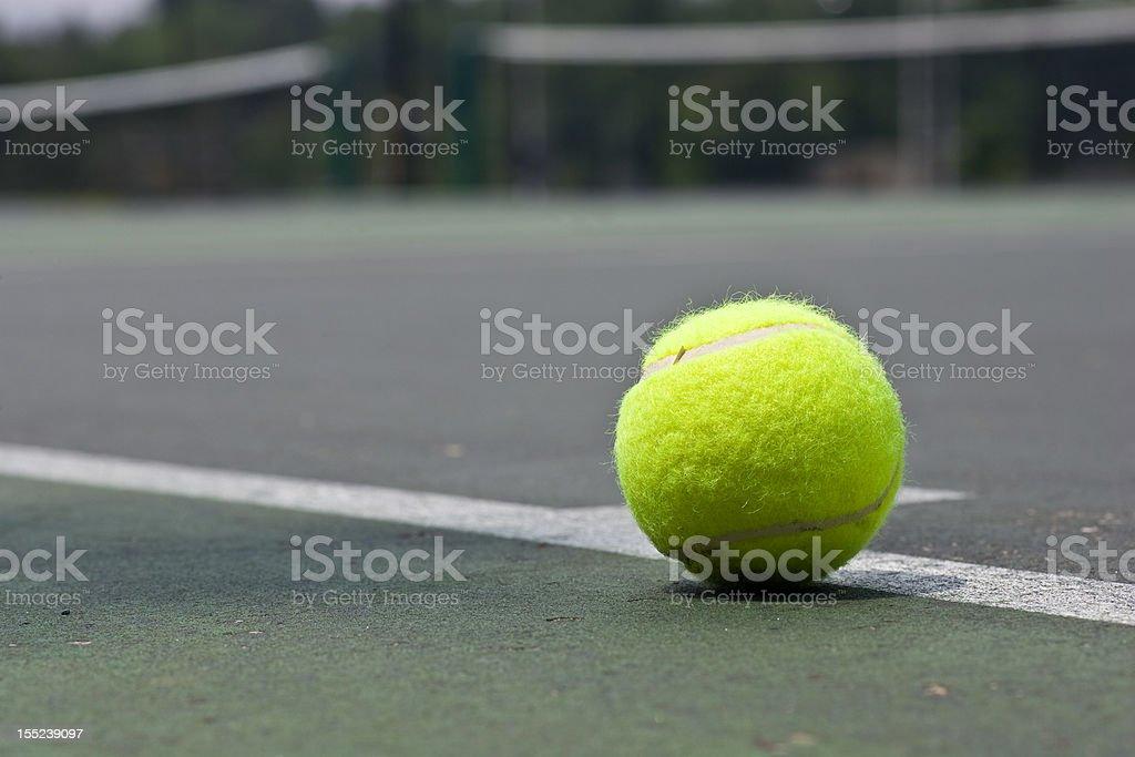 Closeup of tennis ball on base line royalty-free stock photo