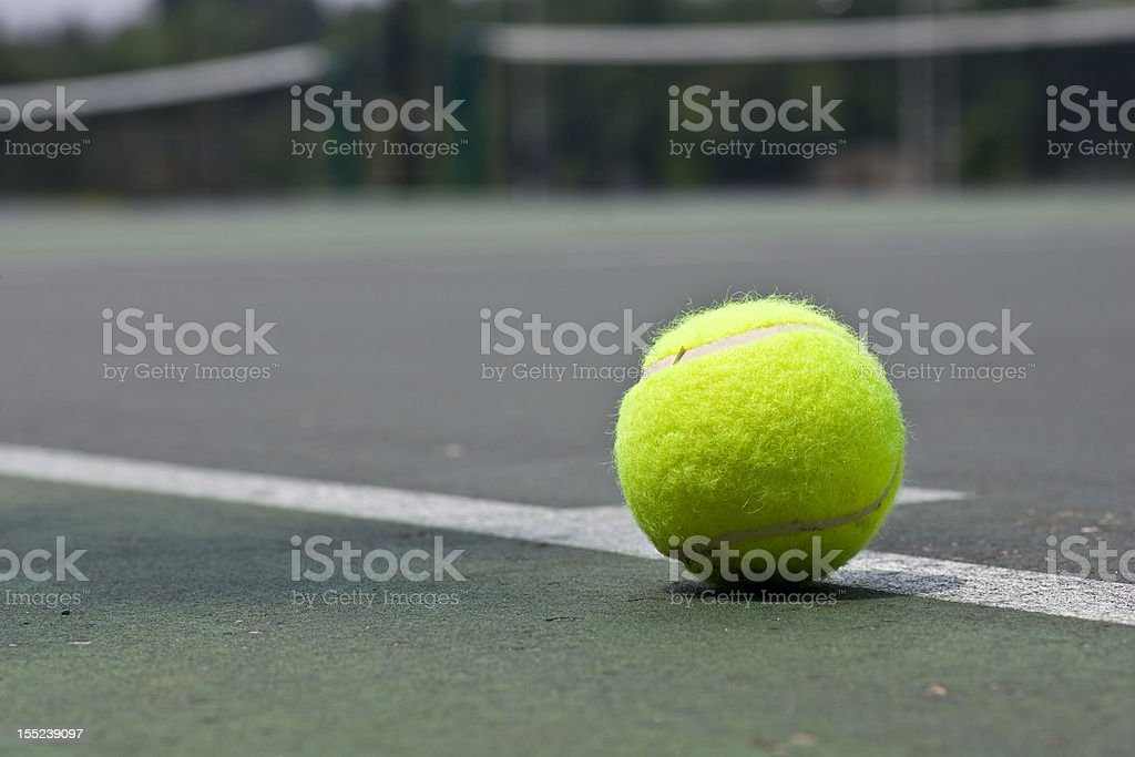 Closeup of tennis ball on base line stock photo