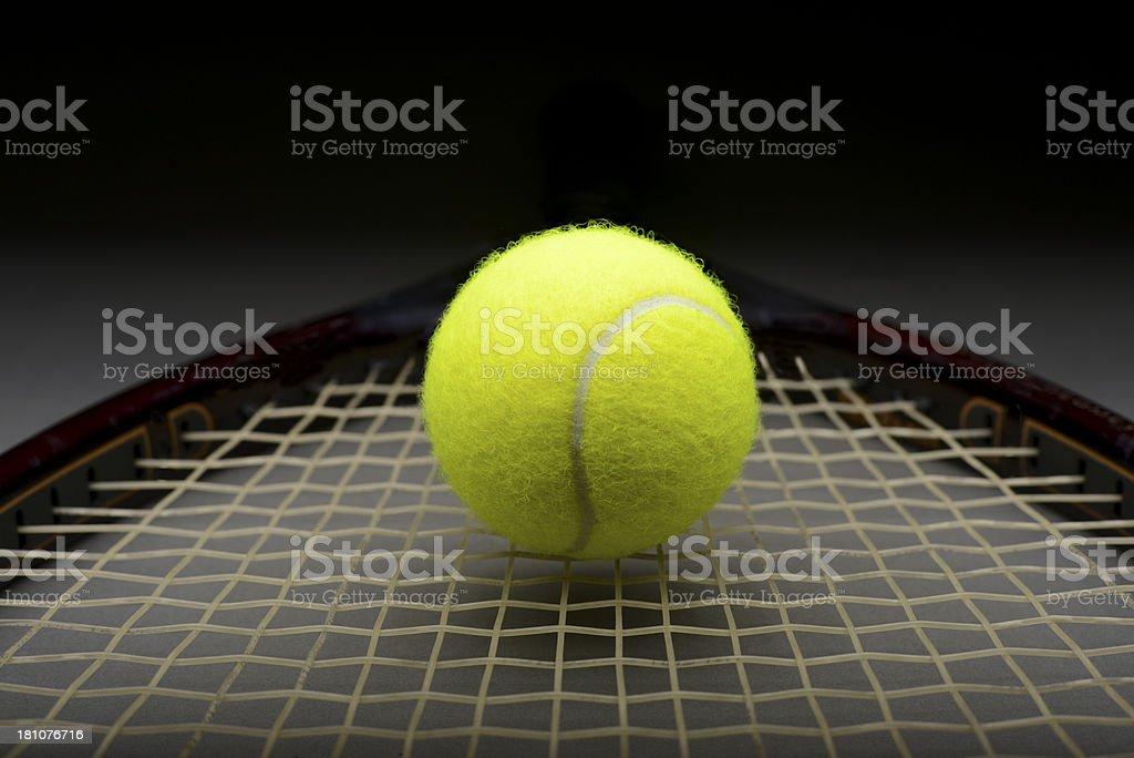 Closeup of tennis ball on racket royalty-free stock photo