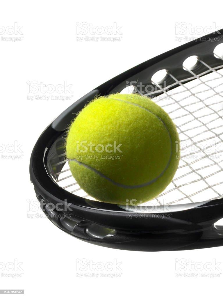 Closeup of tennis ball on racket stock photo