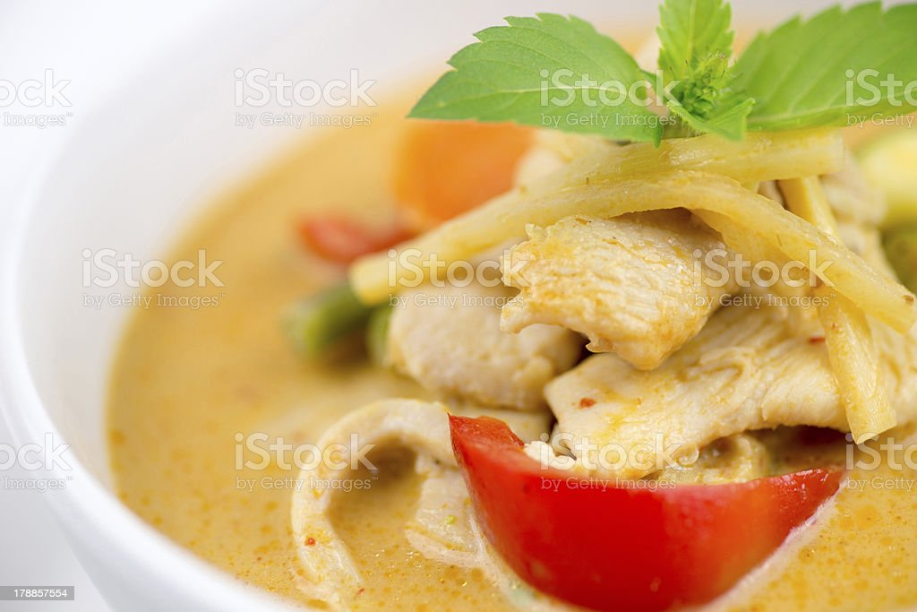 Close-up of Thai chicken red curry with mixed vegetables stock photo