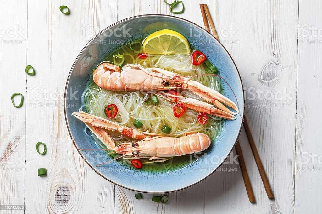 Closeup of Thai soup with scampi and noodles royalty-free stock photo