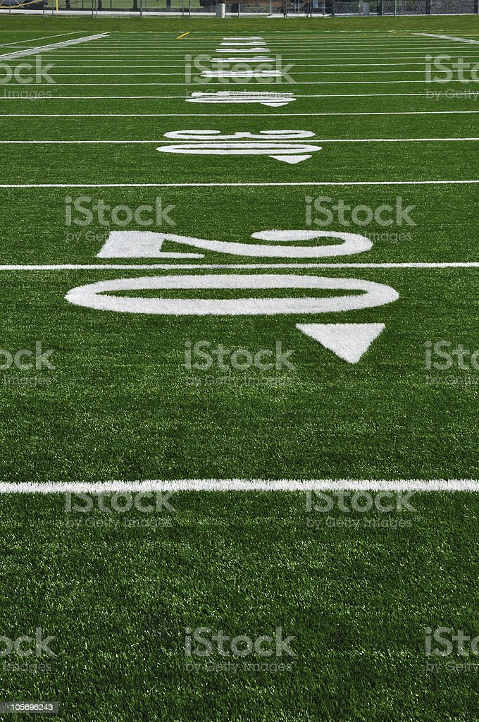 Close-up of the 20 yard line at an American Football Field stock photo