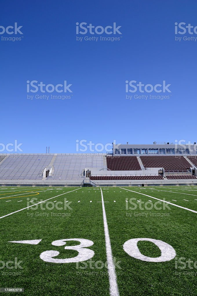 A close-up of the 30 yard line on a football field stock photo