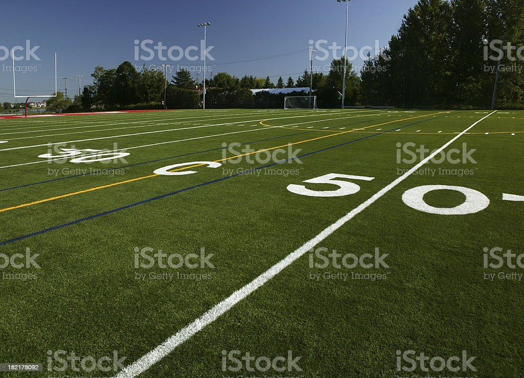 Close-up of the 50-yard line of a football field royalty-free stock photo