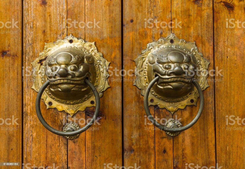 closeup of the antique oriental door knocker stock photo